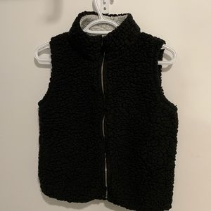 black fuzzy vest
